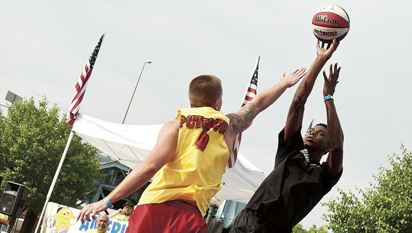 Andrew Wiggins, the top-rated high school player in the country, with Team Get Buckets attempts to score during a Top Men's match against Sick Wit It at the Gus Macker 3-on-3 Basketball Tournament Saturday in downtown Ironton.