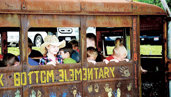 Rock Hill Preschool students have fun in the hillbilly bus during a visit from the Shriners Club. The children contributed $793.38, gathered over a period of a month, for Pennies for Shriners.