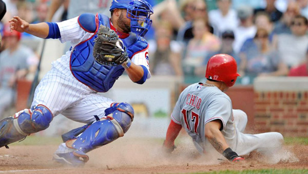 Chicago Cubs' catcher Welington Castillo is late with the tag as Cincinnati Reds' Shin-Soo Choo scores the tying run on a single by Brandon Phillips during the sixth inning of Wednesday's game. Todd Frazier hit a solo home run in the seventh inning to give the Reds a 2-1 win.(Photo Courtesy of The Cincinnati Reds.com)