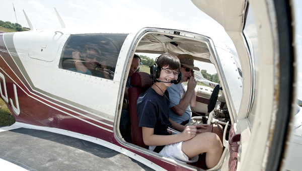 Jack Pancake, 13, of Ashland, Ky., sits in the co-pilot's seat before taking off in a four-seat airplane with his grandmother, Glenda Marshall, and friend, James Murphy, Saturday at the Lawrence County Airpark's Community Plane Ride Day.