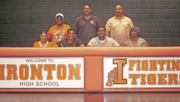 Ironton Fighting Tigers' All-Ohio senior basketball standouts Zac Carter and Trey Fletcher both signed a letter-of-intent to play at Walsh University. Attending the ceremony were: seated from left to right, mother Aleesha Carter, Zac, Trey, mother Monica Fletcher; standing from left to right, father Randall Carter, Ironton head coach Mark LaFon and father Joe Fletcher Jr. (The Ironton Tribune / Jimmy Walker)