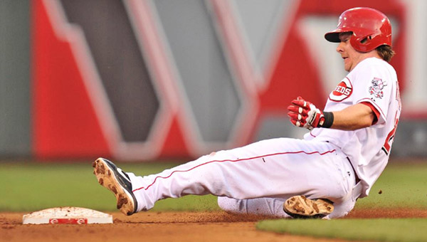 Cincinnati catcher Ryan Hanigan slides safely into second base with a run-scoring double during Tuesday's game. The Reds were unable to hold onto a 4-3 lead as the Colorado Rockies rallied in the eighth inning to win 5-4. (Photo Courtesy of the Cincinnati Reds.com)