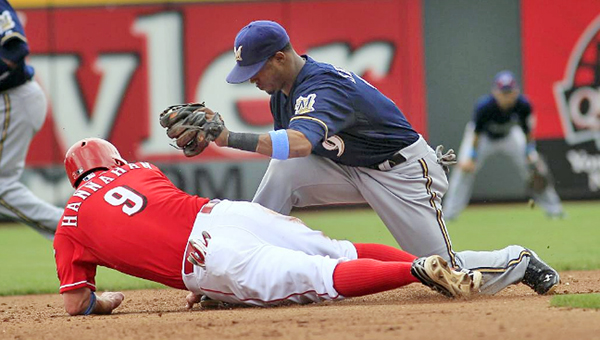 Cincinnati Reds' third baseman Jack Hannahan (9) dives safely back into second base as Jean Segura tries to tag him in the fourth inning. (Photo Courtesy of The Cincinnati Reds)