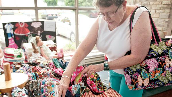 Kay Kelly, of Ironton, browses through homemade wares.