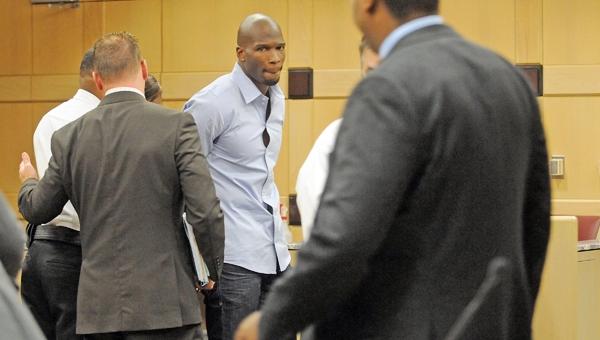 Court bailiffs hand cuff former Miami Dolphins wide receiver Chad Johnson after he was sentenced to 30 days in jail for a pat on his attorney's butt Monday in Fort Lauderdale, Fla. Johnson was in court on a probation violation charge and had worked out a plea deal with prosecutors that would have kept him out of jail. Broward Circuit Judge Kathleen McHugh, however, rejected the plea deal after Johnson playfully patted his lawyer, Adam Swickle, during the proceedings. (MCT DIrect Photo)