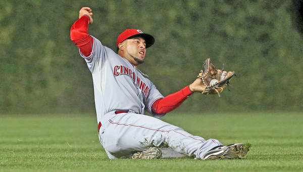 Cincinnati Reds left fielder Xavier Paul (26) makes a catch on a fly out by Chicago Cubs second baseman Darwin Barney (15) during the fifth inning at Wrigley Field in Chicago on Monday. The Reds won 6-2. (MCT Direct Photos)