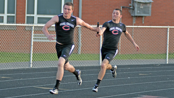 Coal Grove Hornets' senior Bryan Steele (left) takes the baton from Alex Bare during the 4x100 relay event. Steele has returned from ACL surgery in August to enjoy a stellar track season. (Kent Sanborn of Southern Ohio Sports Photos)