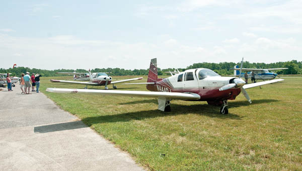 Planes unload passengers during a community fly-in recently at the Lawrence County Airpark.