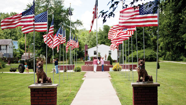 Visitors stop to check out the Southeast Ohio War Memorial in Proctorville Friday before the start of a Flag Day ceremony presented by the Proctorville VFW 6878.