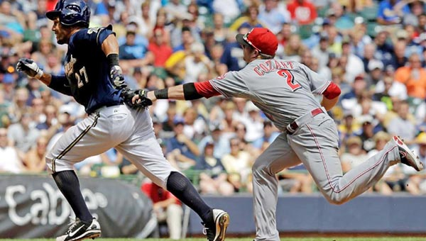 Cincinnati shortstop Zack Cozart tags out Milwaukee Brewers' Carlos Gomez during a fourth inning rundown play. The Reds beat the Brewers 6-2 on Wednesday. (Photo Courtesy of The Cincinnati Reds)