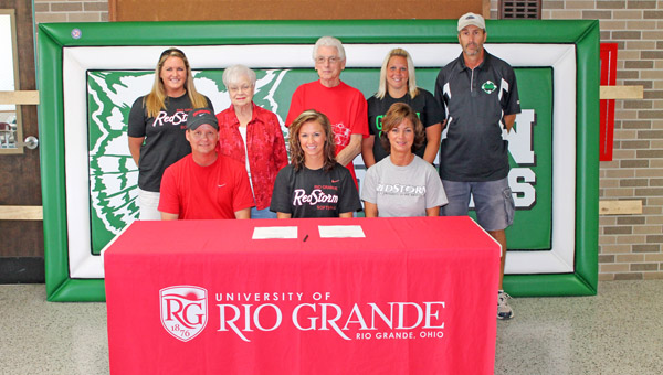 Green Lady Bobcats senior softball standout Jenna Crawford signed a letter-of-intent to play for the University of Rio Grande next season. Attending the signing ceremony were: seated from left to right, father Rocky Crawford, Jenna, and mother Kathy Crawford; standing from left to right, Rio Grande head coach Kristen Bradshaw, grandmother Patty Roadcup, grandfather Orion Roadcup, Green coach Erika Merrill and Green head coach Dale Royse. (Photo Courtesy Randy Payton of The University of Rio Grande)