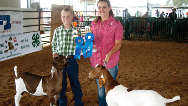 Dylan Back and C.J. Spears show off their trophies for taking top junior and senior showmanship honors.