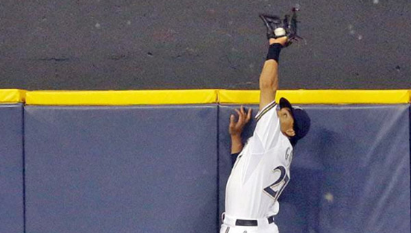 Milwaukee Brewers' centerfielder Carlos Gomez makes a leaping catch to rob Joey Votto of a two-run homer in the ninth inning and preserve a 4-3 win on Monday. (Photo Courtesy of The Cincinnati Reds)