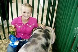 Kara Saunders of Scottown took junior showmanship honors in the hog category.