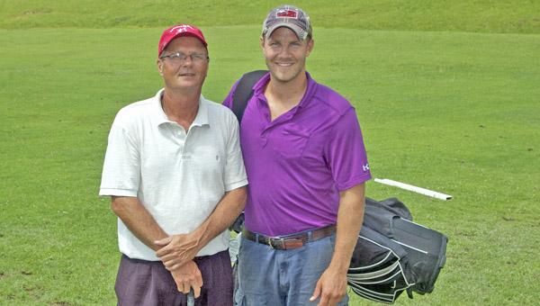 Ironton golfer John Gagai, left, and his caddy, son Dennis Gagai, get ready to head for Omaha, Neb., for the U.S. Senior Open golf tournament. (The Ironton Tribune / Jimmy Walker)