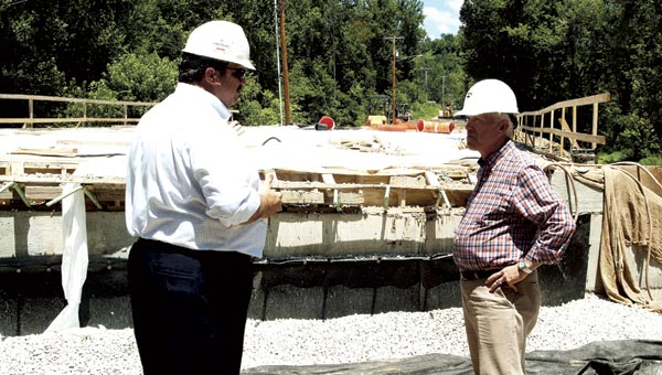 Rep. Bill Johnson (R-6) and Lawrence County Engineer Doug Cade, left, look over the progress at the County Road 22 bridge replacement project on Monday.