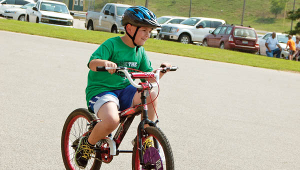 Jacob Edmonds, 8, pedals on his own.
