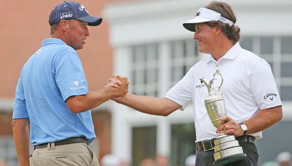 Caddie Jim Mackay, left, congratulates USA's Phil Mickelson, right, on winning the British Open Championship at Muirfield in Gullane, Scotland, on Sunday. (MCT Direct Photo)