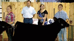 Markie Norris won grand champion and Brenna Norris earned reserve champion in the feeder steer category. Morris also won the showmanship honor in class one for the feeder calves. Also pictured are cattle judge Neal Branscum, from Nancy, Ky., and Lawrence County Fair Queen Skye Barnett.