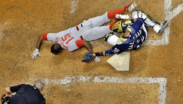 Cincinnati's Derrick Robinson (15) is tagged out at home plate by Milwaukee Brewers' catcher Martin Maldonado as he tries to complete a potential inside-the-park home run. The Reds lost 2-0. (Photo Courtesy of The Cincinnati Reds)