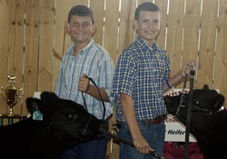Uriah Cade, at left, won grand champion in the feeder heifer category while his cousin, Ethan Cade, won reserve champion.