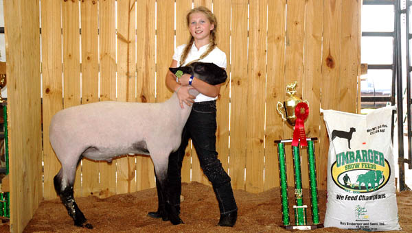 Willow Maynard holds one of her prize lambs.