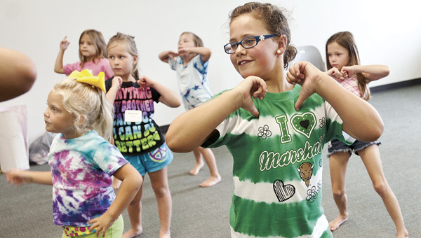 (ABOVE) Gracie Dillon works on her routine with her classmates during dance class Wednesday at the Academy of Excellence at Ohio University Proctorville Center.