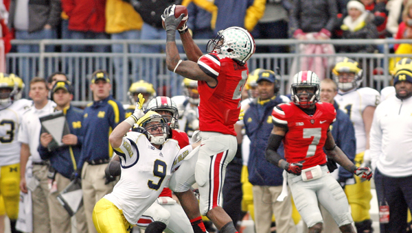Ohio State's C.J. Barnett (4) intercepts a pass intended for Michigan's Drew Dileo (9) during last season. Barnett and the other Buckeyes are expecting a tough week of practice. (MCT Direct Photo)
