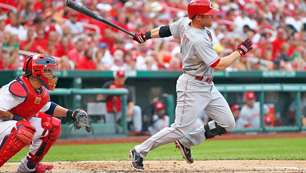 CIncinnati shortstop Zack Cozart triples home Jay Bruce and Devin Mesoraco in the second inning during Monday's game at St. Louis. Cozart had two hits and three RBIs but the Reds lost to the Cardinals 8-6. (Photo Courtesy of The Cincinnati Reds)