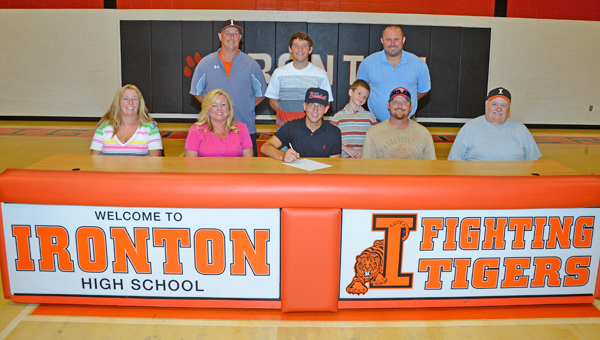Ironton Fighting Tigers' senior baseball standout Steven Easterling signed a letter-of-intent to play at Shawnee State University. Attending the signing ceremony were: seated from left to right, grandmother Cindy Stacy, mother Pamela Stacy, Steven, father Steve Easterling and grandfather Freddie Easterling; standing from left to right, Ironton head coach Larry Goodwin, brother Aiden Easterling, and Shawnee State assistant coach Chris Moore. (Kent Sanborn of Southern Ohio Sports Photos)