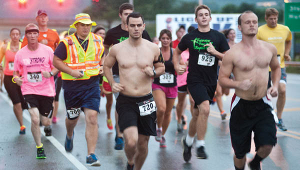 Runners take off from the Kroger parking lot to take part in the Light Up the Night JPK 5K Glo Run Friday in Proctorville.