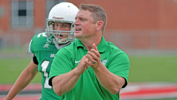 Cullen Homolka offers encouragement to his team during Saturday's Ohio Valley Conference preview. Homolka is in his first year as the Fairland Dragons head coach. (Kent Sanborn of Southern Ohio Sports Photos)
