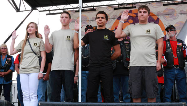 our local teenagers took the oath of enlistment Saturday during the Vietnam Veterans Tribute. This was part of the annual Parade of Heroes that included hundreds of motorcycles and veterans who came to show their respect for their fallen brothers and sisters.