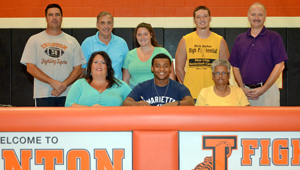 Ironton Fighting Tigers' senior running back Patrick Lewis signed a letter-of-intent to play for Marietta College. Attending the signing ceremony were: seated from left to right, Heather Dutey, Patrick, grandmother Jackie Birchfield; standing from left to right, Ironton head coach Mark Vass, Gary Dutey, Taitlyn Dutey, Tanner Dutey and Scott Dutey. (Tony Shotsky of Southern Ohio Sports Photos)