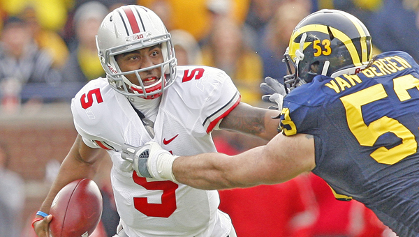 Ohio State Buckeyes' quarterback Braxton Miller tries to escape the grasp of a Michigan defender during a game last season. Miller said he is doing a better job of handling the spotlight this year. (MCT Direct Photos)
