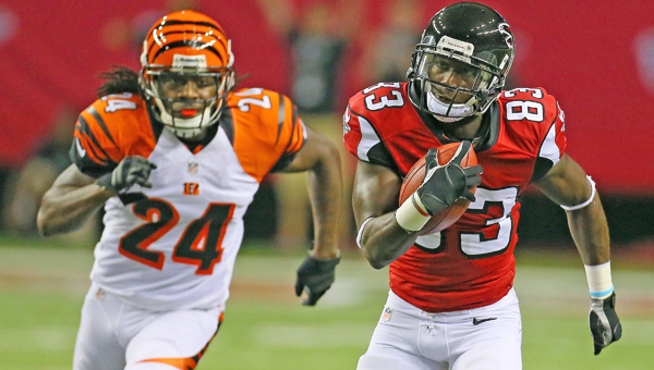 Atlanta Falcons wide receiver Harry Douglas (83) breaks away from Cincinnati Bengals cornerback Adam Jones (24) for a long gain on the opening drive of preseason action at the Georgia Dome on Thursday. The Bengals won 34-10. (MCT Direct Photos)