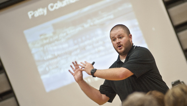Law Enforcement Training Officer James Burke talks to faculty and staff at Rock Hill.