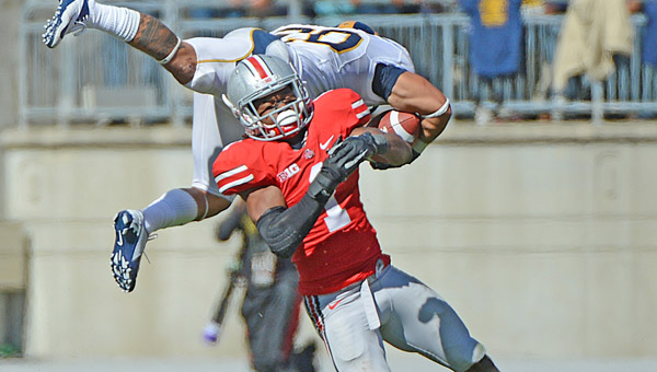 Ohio State defensive back Bradly Roby upends California Golden Bears running back Isi Sofele (20) during a game last season. Roby has been suspended along with two other players for the Buckeyes' opening game Aug. 31 against Buffalo. (MCT Direct Photo)