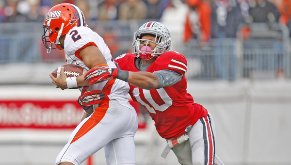 Ohio State Buckeyes linebacker Ryan Shazier (10) tackles Illinois Fighting Illini quarterback Nathan Scheelhaase (2) during a game last season. Shazier is one of the keys to the Buckeyes' defense this season. (MCT Direct Photo)