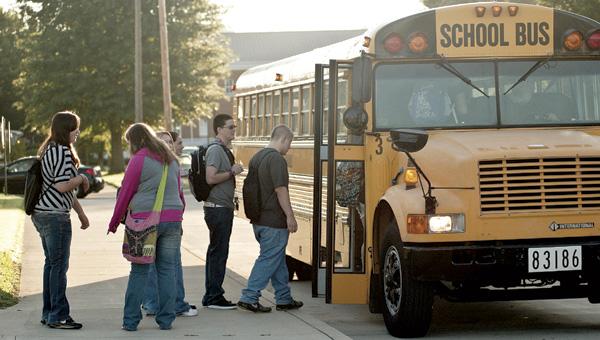 Ironton High School students board the bus.