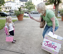Amy Shimer takes a moment to get a first day of school photo of her daughter, Haley at St. Lawrence.