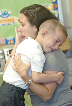 Five-year-old Blake and his mother, Mandy Medinger, experience kindergarten jitters as he enters St. Lawrence school.