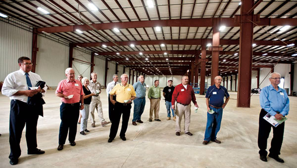 Visitors gather inside the new Orica building as part of a three-business tour at The Point industrial park Friday.Visitors gather inside the new Orica building as part of a three-business tour at The Point industrial park Friday.