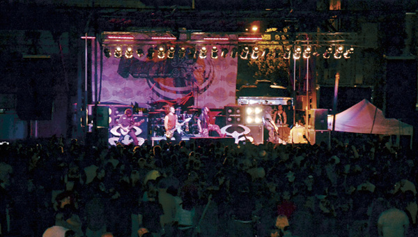 The band Nonpoint performs for hundreds of people in downtown.