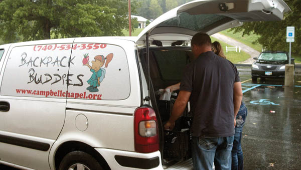 Jodie and Jason Hunt unload the Backpack Buddies van at the Rock Hill School District Thursday. Each week, food is brought in for children in need to take home over the weekend.