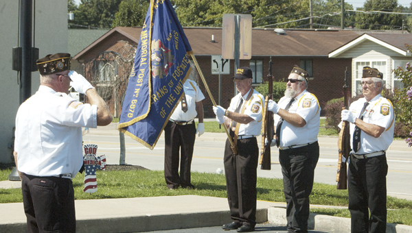 Members of Veterans of Foreign Wars Post 6878, Proctorville, stand attention as Taps is played during the 9/11 ceremony at WesBanco in Proctorville on Saturday.