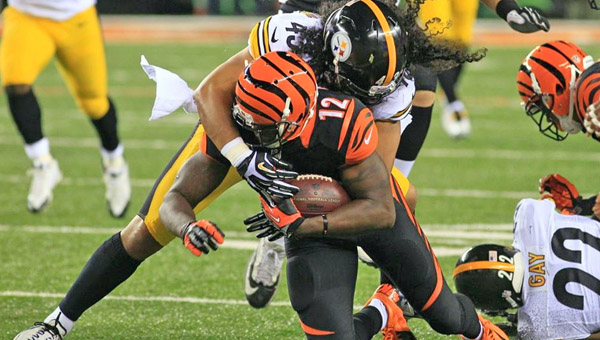 Cincinnati wide receiver Sanu Mohamed (12) is brought down by Pittsburgh Steelers' safety Troy Polamalu after a big gain during Monday's NFL game at Paul Brown Stadium in Cincinnati. The Bengals won 20-10. (Photo Courtesy of The CIncinnati Bengals.com)