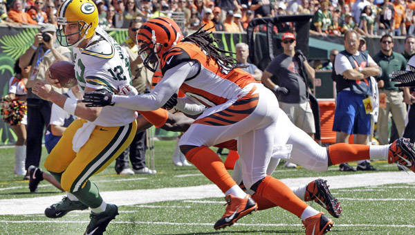 Cincinnati Bengals' cornerback Leon Hall (29) is tackled by Green Bay Packers' wide receiver Randall Cobb (18) after intercepting a pass during the fourth quarter on Sunday at Paul Brown Stadium in Cincinnati. The Bengals won 34-30. (MCT Direct Photo)