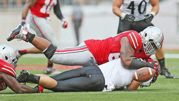 Ohio State Buckeyes defensive lineman Michael Bennett (63) forces a fumble as he sacks San Diego State Aztecs quarterback Quinn Kaehler (18) during a game earlier this season. Bennett is one of the key players on the Buckeyes' defense. (MCT Direct Photo)