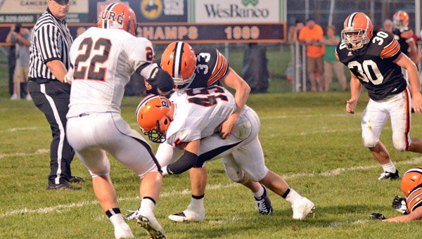 Ironton Fighting Tigers' linebacker Jeremy Bodmer (33) brings down Wheelersburg running back Micah McAlister (45). Ironton hosts Russell on Friday. (Tony Shotsky of Southern Ohio Sports Photos)